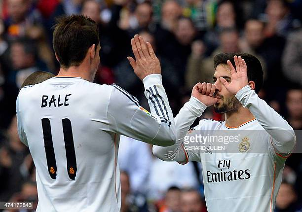 Real Madrid's midfielder Isco celebrates with Real Madrid's Welsh striker Gareth Bale after scoring during the Spanish league football match Real...