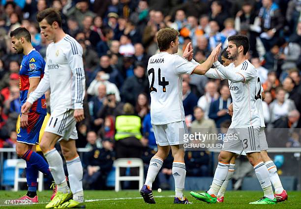 Real Madrid's midfielder Isco is congratuled after scoring by Real Madrid's midfielder Asier Illarramendi as Real Madrid's Welsh striker Gareth Bale...