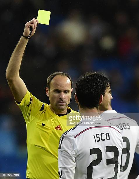 Real Madrid's midfielder Isco is shown a yellow card during the Spanish Copa del Rey round of 16 second leg football match Real Madrid CF vs Club...