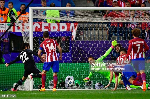 Real Madrid's midfielder Isco scores past Atletico Madrid's Slovenian goalkeeper Jan Oblak during the UEFA Champions League semi final second leg...