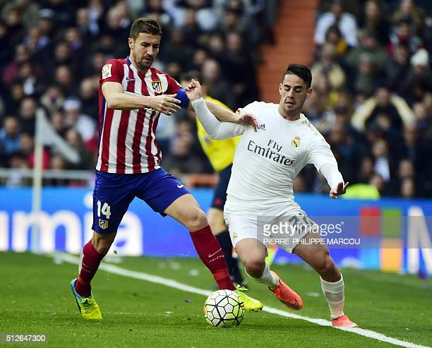 Real Madrid's midfielder Isco vies with Atletico Madrid's midfielder Gabi during the Spanish league football match Real Madrid CF vs Club Atletico de...