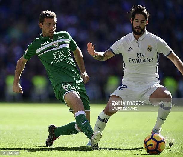 Real Madrid's midfielder Isco vies with Leganes's midfielder Alberto Martin during the Spanish league football match Real Madrid CF vs Club Deportivo...