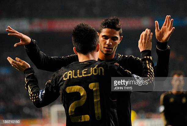 Real Madrid's midfielder Jose Maria Callejon celebrates after scoring with Real Madrid's Pedro Mendes during the the UEFA Champions League Group E...