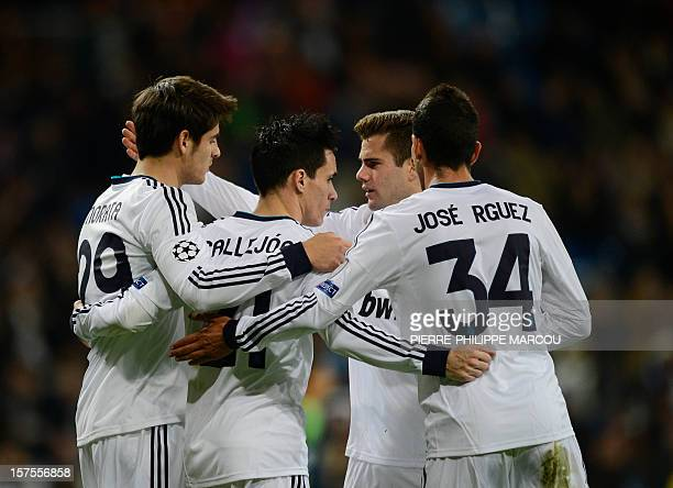 Real Madrid's midfielder Jose Maria Callejon celebrates with his teammates after scoring his second goal during the UEFA Champions League football...