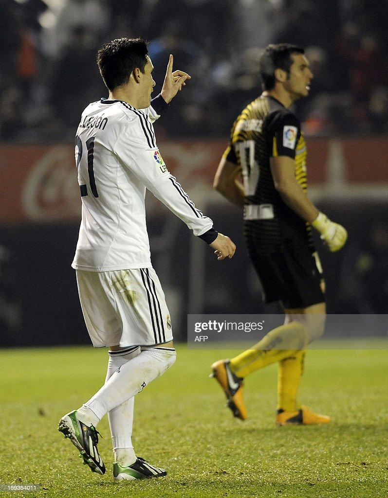 Real Madrid's midfielder Jose Maria Callejon (L) gestures during the Spanish league football match CA Osasuna vs Real Madrid CF at the Reyno de Navarra stadium in Pamplona on January 12, 2013.