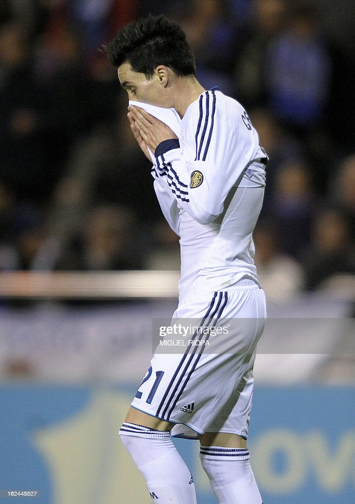 Real Madrid's midfielder Jose Maria Callejon reacts after missing an opportunity to score during the Spanish league football match RC Deportivo de la Coruna vs Real Madrid CF at Riazor stadium in Coruna on February 23, 2013.