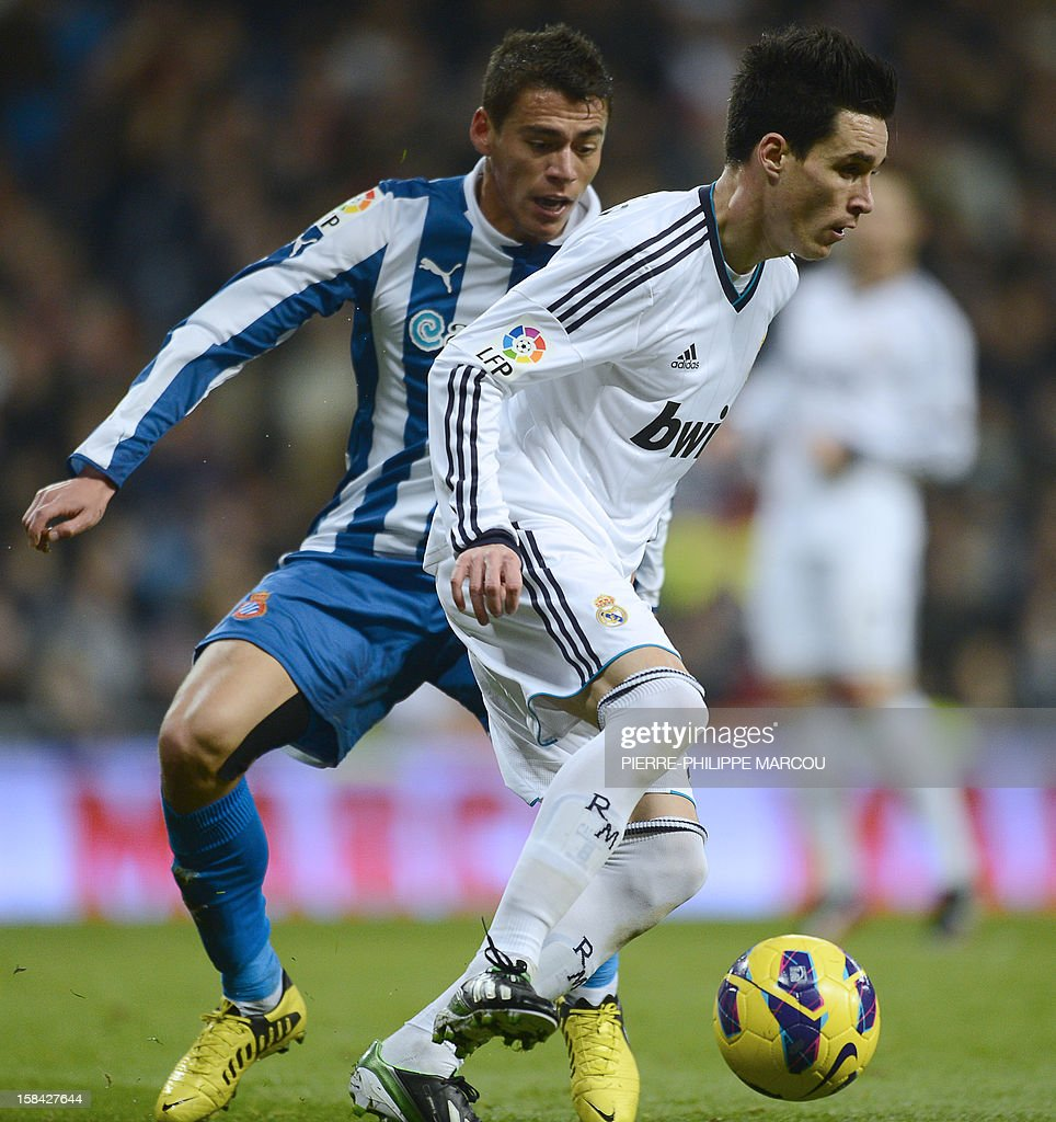 Real Madrid s midfielder Jose Maria Callejon R vies with