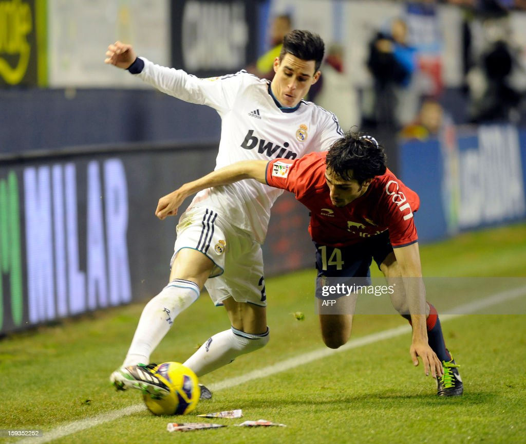 Real Madrid's midfielder Jose Maria Callejon (L) vies with Osasuna's defender Alejandro Arribas (R) during the Spanish league football match CA Osasuna vs Real Madrid CF at the Reyno de Navarra stadium in Pamplona on January 12, 2013.