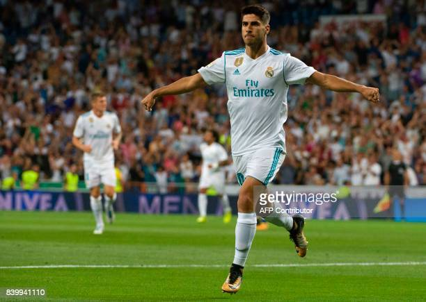 Real Madrid's midfielder Marco Asensio celebrates after scoring during the Spanish league football match Real Madrid CF vs Valencia CF at the...