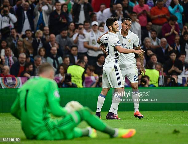 Real Madrid's midfielder Marco Asensio celebrates beside Real Madrid's Brazilian defender Danil after scoring during the UEFA Champions League...