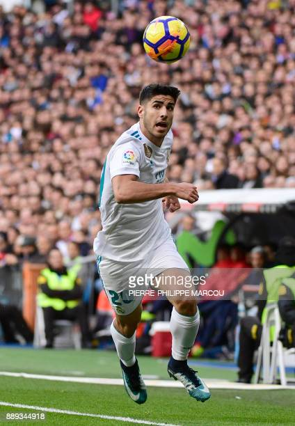 Real Madrid's midfielder Marco Asensio controls the ball during the Spanish league football match between Real Madrid and Sevilla at the Santiago...