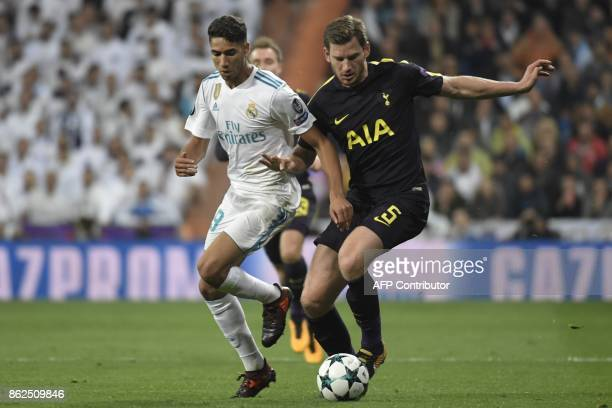 Real Madrid's Moroccan defender Achraf Hakimi vies with Tottenham Hotspur's Belgian defender Jan Vertonghen during the UEFA Champions League group H...