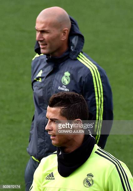 Real Madrid's new French coach Zinedine Zidane and Real Madrid's Portuguese forward Cristiano Ronaldo take part in a training session at the...