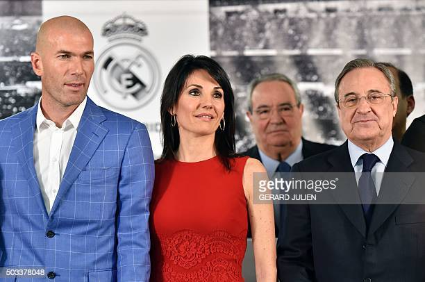 Real Madrid's new French coach Zinedine Zidane poses with his wife Veronique and Real Madrid's president Florentino Perez after a statement at the...