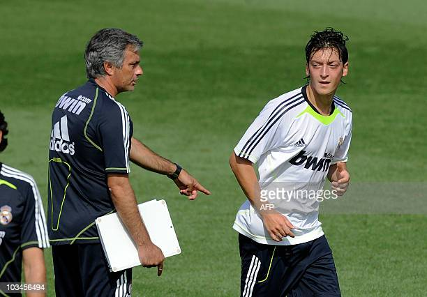 Real Madrid's new German player Mesut Ozil and coach Jose Mourinho attend a training session at the Real Madrid Sports City in Madrid on August 19...