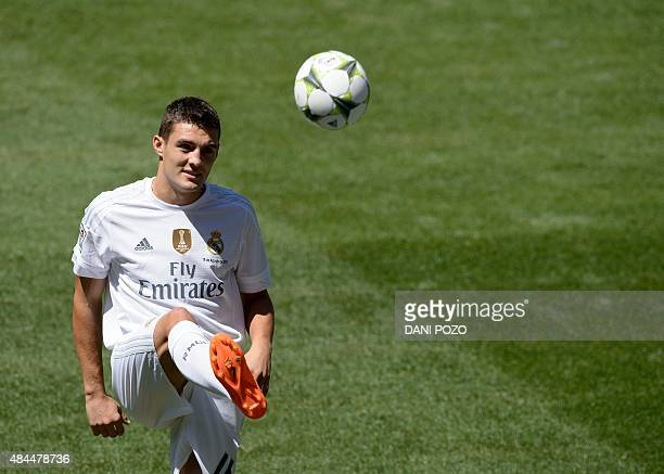 Real Madrid's new player Croatian Mateo Kovacic kicks the ball as he poses during his official presentation at the Santiago Bernabeu stadium in...