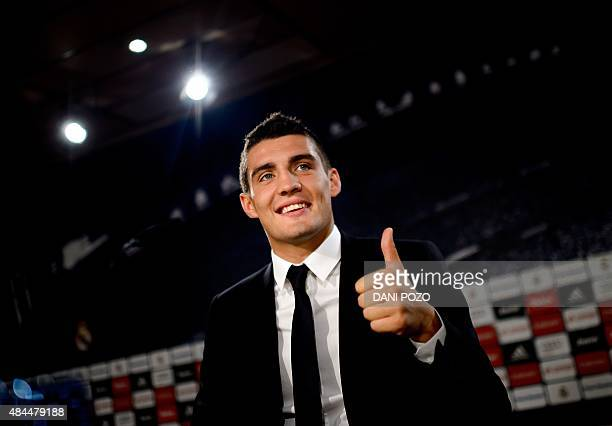 Real Madrid's new player Croatian Mateo Kovacic thumbs up during his official presentation at the Santiago Bernabeu stadium in Madrid on August 19...