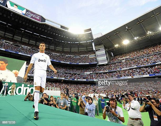 Real Madrid's new player Portuguese Cristiano Ronaldo gestures during his official presentation at the Santiago Bernabeu stadium in Madrid on July 6...