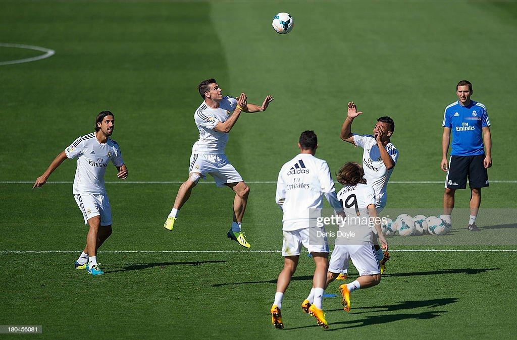 Real Madrid's new signing <a gi-track='captionPersonalityLinkClicked' href=/galleries/search?phrase=Gareth+Bale&family=editorial&specificpeople=609290 ng-click='$event.stopPropagation()'>Gareth Bale</a> (2L) heads the ball during a team training session on September 13, 2013 in Madrid, Spain.