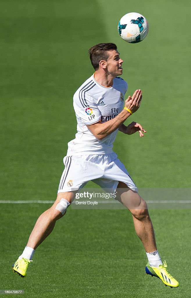 Real Madrid's new signing <a gi-track='captionPersonalityLinkClicked' href=/galleries/search?phrase=Gareth+Bale&family=editorial&specificpeople=609290 ng-click='$event.stopPropagation()'>Gareth Bale</a> heads the ball during a team training session on September 13, 2013 in Madrid, Spain.