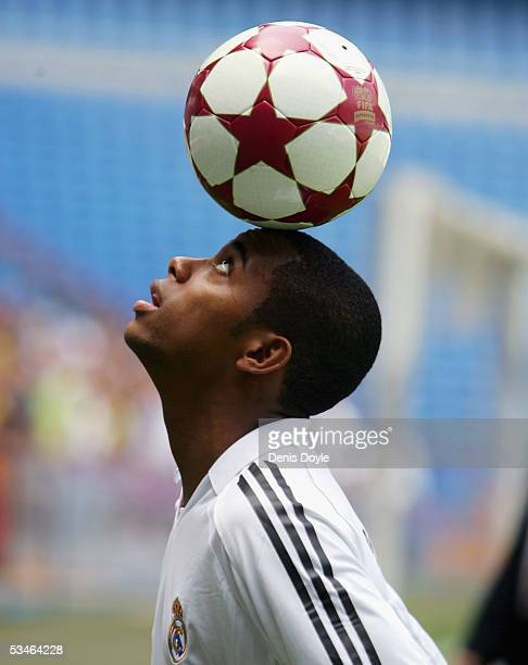 Real Madrid's new signing Robinho balances a ball during his presentation for Real Madrid at the Bernabeu on August 26 2005 in Madrid Spain Robinho...