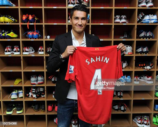 Real Madrid's Nuri Sahin poses as he signs a seasonlong loan with Liverpool FC at Melwood training Ground on August 25 2012 in Liverpool England
