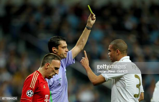 Real Madrid's Pepe argues as he is booked by referee Viktor Kassai