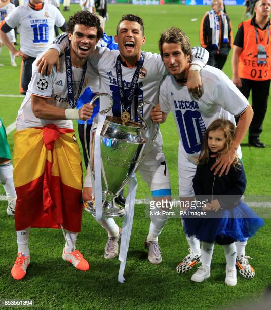 Real Madrid's Pepe Cristiano Ronaldo and Fabio Coentrao celebrate with the UEFA Champions League Trophy after the UEFA Champions League Final at at...