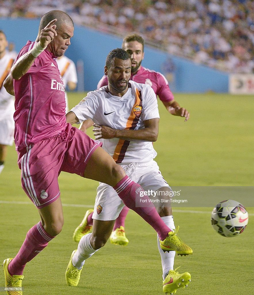 Real Madrid's Pepe, left, stops AS Roma's Ashley Cole in the Guinness International Champions Cup at the Cotton Bowl in Dallas on Tuesday, July 29, 2014.