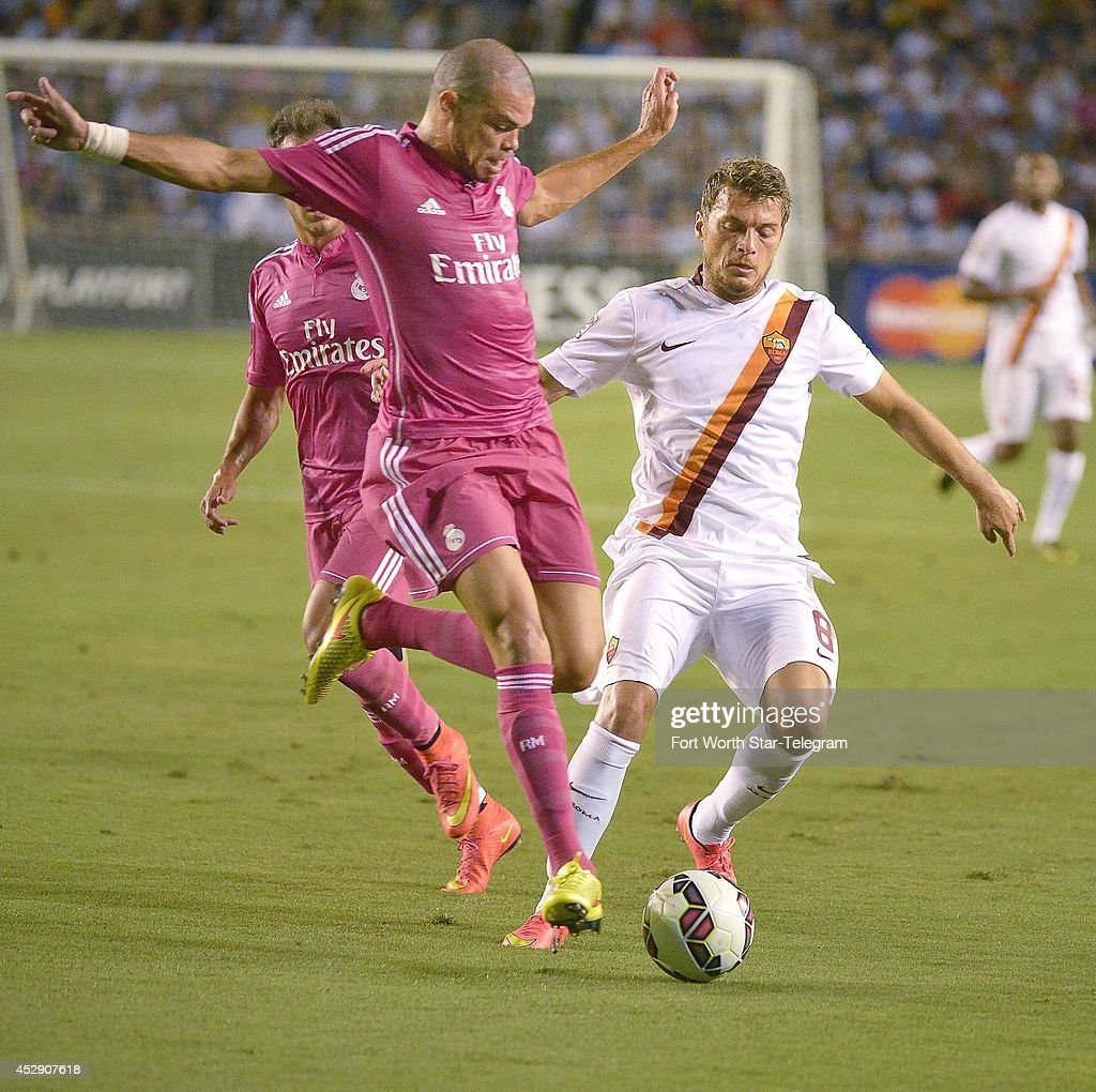 Real Madrid's Pepe stops AS Roma's Adem Ljajicin, right, in the Guinness International Champions Cup at the Cotton Bowl in Dallas on Tuesday, July 29, 2014.