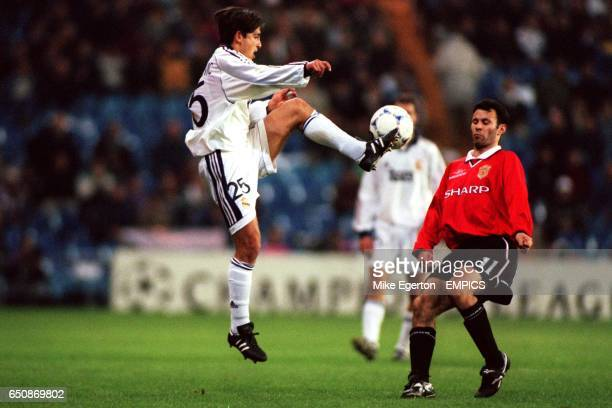 LR Real Madrid's perica Ogjenovic controls the ball under pressure from Manchester United's Ryan Giggs
