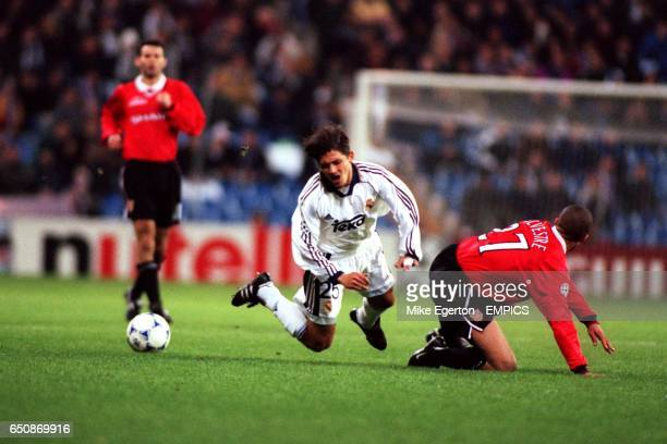 LR Real Madrid's Perica Ogjenovic is tackled by Manchester United's Mikael Silvestre