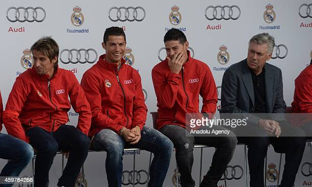 Real Madrid's player Cristiano Ronaldo James Rodrigez and head coach Carlo Ancelotti during a promotion event for delivering Audi vehicles to each...