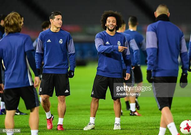 Real Madrid's player James Rodriguez and Marcelo attend a training session before 2016 FIFA Club World Cup semifinal match between Real Madrid and...