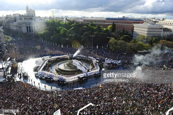 Real Madrid's players arrive on an open bus at Cibeles square in Madrid on May 3 to celebrate winning the Spanish league title for the first time...