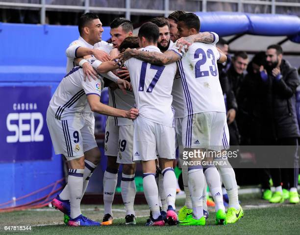 Real Madrid's players celebrate after French forward Karim Benzema scored their team's first goal during the Spanish league football match SD Eibar...