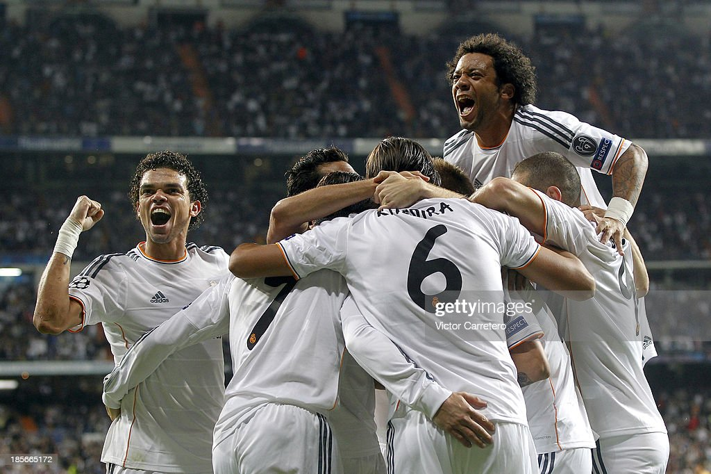 Real Madrid's players celebrate after scoring the opening goal during the UEFA Champions League Group B match between Real Madrid and Juventus at Estadio Santiago Bernabeu on October 23, 2013 in Madrid, Spain.