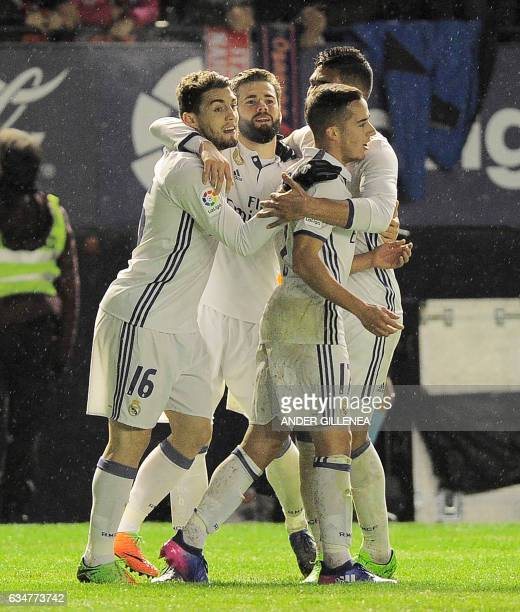 Real Madrid's players celebrate after the team's third goal during the Spanish league football match CA Osasuna vs Real Madrid CF at El Sadar stadium...
