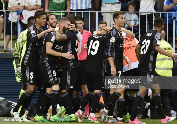 Real Madrid's players celebrate their second goal during the Spanish league football match Malaga CF vs Real Madrid CF at La Rosaleda stadium in...