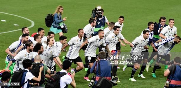 Real Madrid's players celebrate winning the Liga title after the Spanish league football match Malaga CF vs Real Madrid CF at La Rosaleda stadium in...