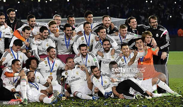 Real Madrid's players celebrate with the trophy after winning the FIFA Club World Cup final football match against San Lorenzo at the Marrakesh...