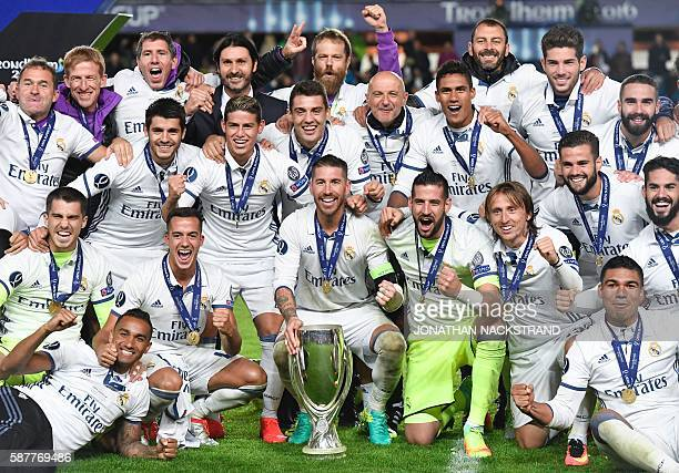 Real Madrid's players celebrate with the trophy after winning the UEFA Super Cup final football match between Real Madrid CF and Sevilla FC on August...