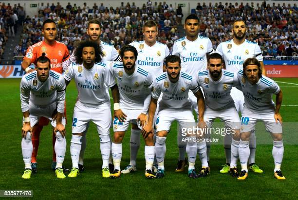 Real Madrid's players Costa Rican goalkeeper Keylor Navas defender Sergio Ramos German midfielder Toni Kroos Brazilian midfielder Casemiro French...
