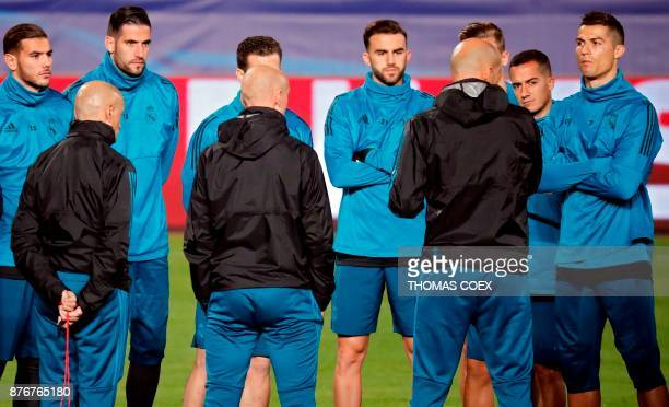 Real Madrid's players listens to Real Madrid's French Head Coach Zinedine Zidane during a training session in the Cypriot capital Nicosia at GSP...