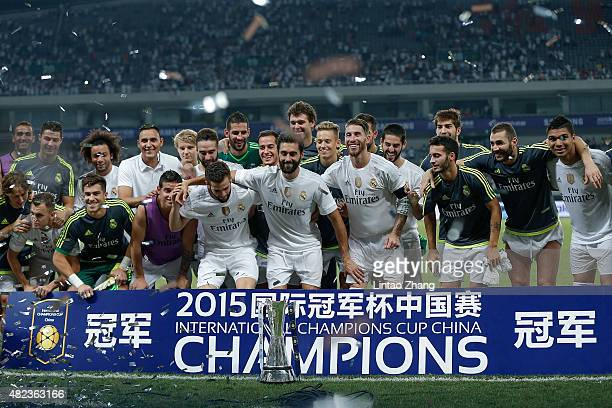 Real Madrid's players pose with the trophy after winning the International Champions Cup match between Real Madrid and AC Milan at Shanghai Stadium...