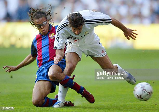 Real Madrid's Portugese Luis Figo fights for the ball with FC Barcelona's Dutch Edgar Davids during the spanish first league football match Real...