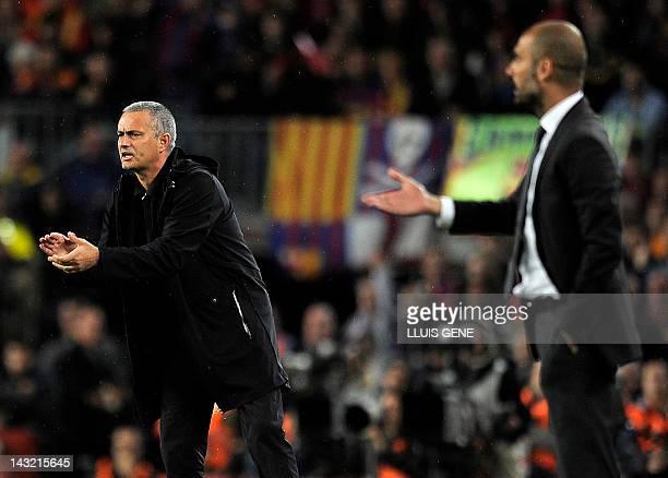Real Madrid's Portuguese coach Jose Mourinho and Barcelona's coach Josep Guardiola react during the Spanish League 'El clasico' football match...