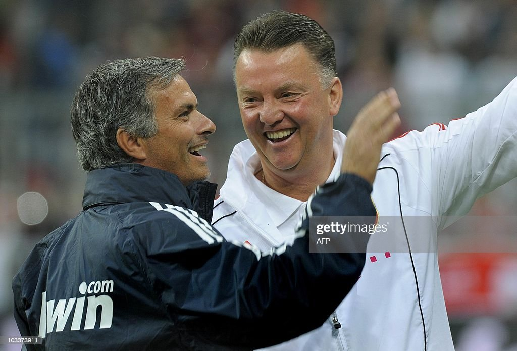 Real Madrid's Portuguese coach Jose Mourinho (L) and Bayern Munich's Dutch coach Louis van Gaal share a laugh before a friendly match between German first football division Bundesliga club FC Bayern Munich and Spanish team Real Madrid in Munich, southern Germany, August 13, 2010. Real Madrid won the match 4-2 after a penalty shootout. The match was organised to honor former Bayern Munich President Franz Beckenbauer.