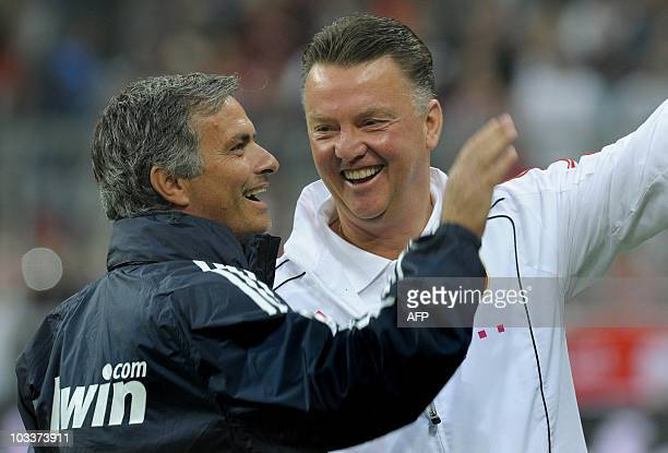 Real Madrid's Portuguese coach Jose Mourinho and Bayern Munich's Dutch coach Louis van Gaal share a laugh before a friendly match between German...