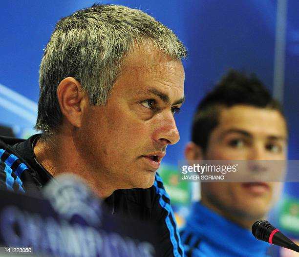 Real Madrid's Portuguese coach Jose Mourinho and Real Madrid's Portuguese forward Cristiano Ronaldo attend a press conference after a training...